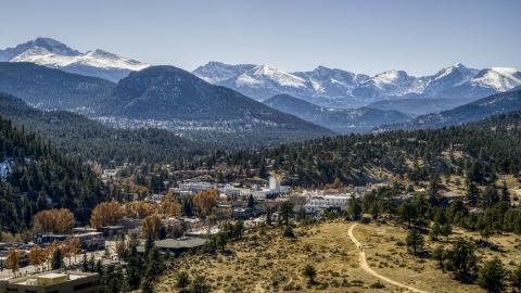 DXP001_000217 - Aerial stock photo of A small town with snowy mountains visible in the distance in Estes Park, Colorado