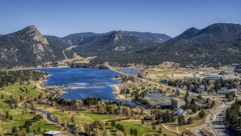 DXP001_000219 - Aerial stock photo of Lake Estes and mountains seen from the golf course in Estes Park, Colorado