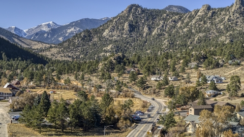DXP001_000228 - Aerial stock photo of Rural homes beside a road near rugged mountains, Estes Park, Colorado