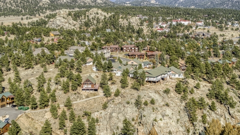 DXP001_000230 - Aerial stock photo of Rural homes on a rugged hillside, Estes Park, Colorado
