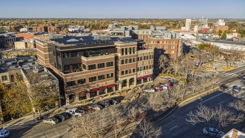 DXP001_000238 - Aerial stock photo of A brick office building by a quiet street in Fort Collins, Colorado