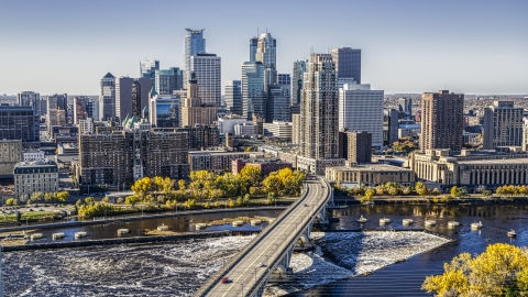 DXP001_000293 - Aerial stock photo of The city skyline on the other side of a bridge spanning the Mississippi River, Downtown Minneapolis, Minnesota