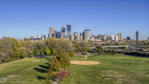 DXP001_000304 - Aerial stock photo of The city skyline's skyscrapers seen from a park, Downtown Minneapolis, Minnesota