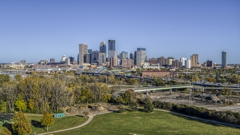 DXP001_000308 - Aerial stock photo of The city's skyline in the distance, seen from a park, Downtown Minneapolis, Minnesota