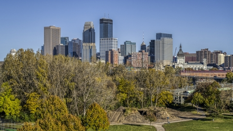 DXP001_000311 - Aerial stock photo of The city's skyline seen from trees at a nearby park, Downtown Minneapolis, Minnesota