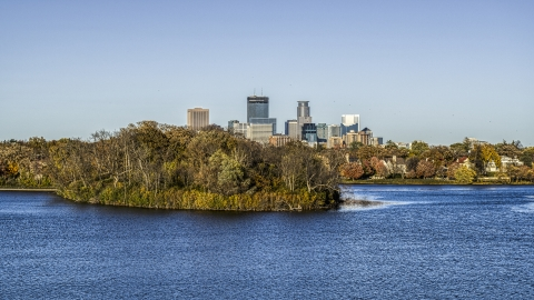 DXP001_000316 - Aerial stock photo of The city skyline's skyscrapers seen from Lake of the Isles, Downtown Minneapolis, Minnesota