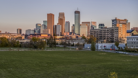 DXP001_000325 - Aerial stock photo of Giant skyscrapers of the city's skyline at sunset seen from a park in Downtown Minneapolis, Minnesota