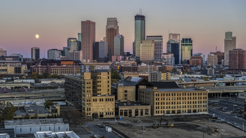 DXP001_000327 - Aerial stock photo of The city's skyline behind a market at sunset in Downtown Minneapolis, Minnesota