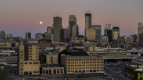 DXP001_000330 - Aerial stock photo of The moon in the sky near the city's skyline at twilight, marketplace building in the foreground, Downtown Minneapolis, Minnesota