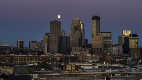 DXP001_000336 - Aerial stock photo of The moon above giant skyscrapers of the city's skyline at twilight, Downtown Minneapolis, Minnesota
