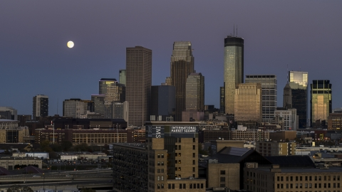 DXP001_000337 - Aerial stock photo of The moon above tall skyscrapers of the city's skyline at twilight, Downtown Minneapolis, Minnesota