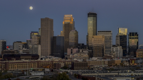DXP001_000343 - Aerial stock photo of A view of the city's skyline at twilight, moon in the sky above skyscrapers, Downtown Minneapolis, Minnesota