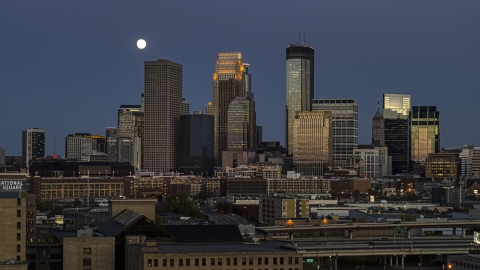 DXP001_000344 - Aerial stock photo of A view of the city's skyline at twilight, moon above skyscrapers, Downtown Minneapolis, Minnesota