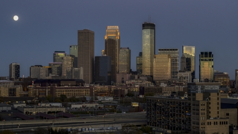 DXP001_000345 - Aerial stock photo of A view of the city's skyline at twilight, moon beside skyscrapers, Downtown Minneapolis, Minnesota