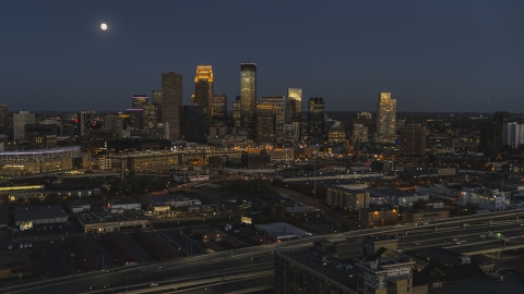 DXP001_000347 - Aerial stock photo of A wide view of the city's skyline at twilight with the moon in the sky, Downtown Minneapolis, Minnesota