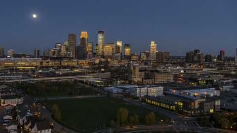 DXP001_000348 - Aerial stock photo of The city's skyline at twilight with the moon in the sky, Downtown Minneapolis, Minnesota