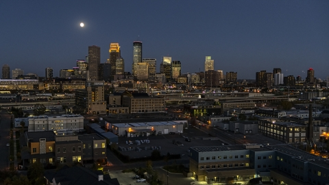 DXP001_000349 - Aerial stock photo of The city's downtown skyline at twilight with the moon in the sky, Downtown Minneapolis, Minnesota