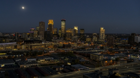 DXP001_000350 - Aerial stock photo of The downtown skyline at twilight with the moon in the sky, Downtown Minneapolis, Minnesota