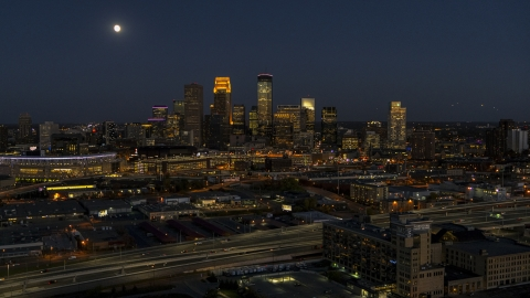 DXP001_000351 - Aerial stock photo of The downtown skyline at twilight and the moon in the sky above, Downtown Minneapolis, Minnesota