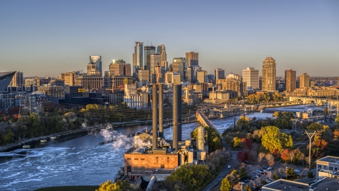 DXP001_000352 - Aerial stock photo of The downtown skyline across the river, seen from power plant at sunrise, Downtown Minneapolis, Minnesota