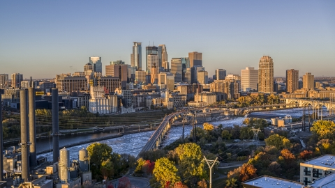 DXP001_000353 - Aerial stock photo of The downtown skyline across the river, seen from a bridge at sunrise, Downtown Minneapolis, Minnesota