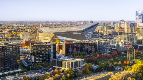 DXP001_000359 - Aerial stock photo of US Bank Stadium behind apartment buildings at sunrise, Downtown Minneapolis, Minnesota