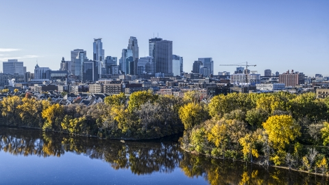 DXP001_000362 - Aerial stock photo of The tree-lined river and the city skyline in the distance, Downtown Minneapolis, Minnesota