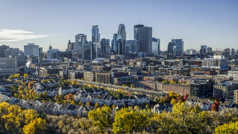 DXP001_000366 - Aerial stock photo of The city's skyline in the distance, seen from a neighborhood, Downtown Minneapolis, Minnesota