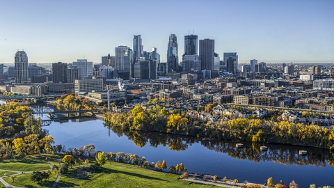 DXP001_000367 - Aerial stock photo of The city's skyline in the distance, seen from the Mississippi River, Downtown Minneapolis, Minnesota