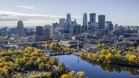 DXP001_000370 - Aerial stock photo of Bridges spanning the Mississippi River, and city skyline in distance, Downtown Minneapolis, Minnesota