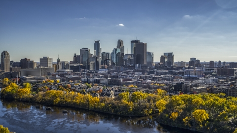DXP001_000396 - Aerial stock photo of City skyline's skyscrapers seen from the Mississippi River with autumn trees, Downtown Minneapolis, Minnesota