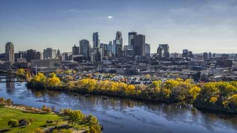 DXP001_000397 - Aerial stock photo of City skyline's skyscrapers seen from the Mississippi River with fall trees, Downtown Minneapolis, Minnesota
