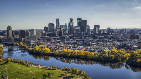 DXP001_000399 - Aerial stock photo of City skyline seen from the Mississippi River with fall trees, Downtown Minneapolis, Minnesota