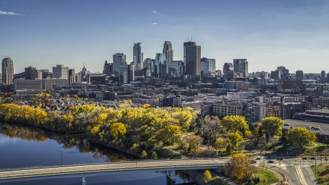 DXP001_000400 - Aerial stock photo of A view of the city skyline from the Mississippi River with fall trees, Downtown Minneapolis, Minnesota