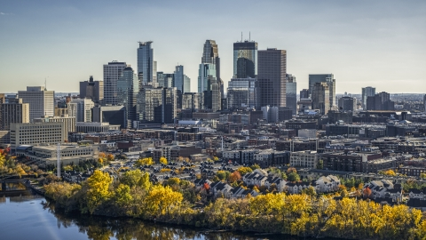 DXP001_000404 - Aerial stock photo of The city's skyline seen from the Mississippi River with autumn trees, Downtown Minneapolis, Minnesota
