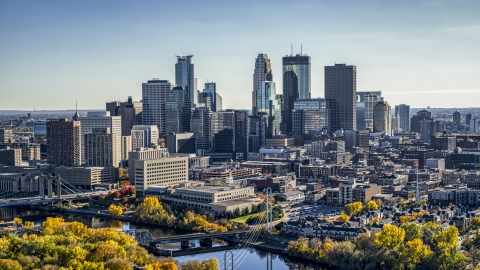 DXP001_000407 - Aerial stock photo of The city's skyline seen from autumn trees by the river, Downtown Minneapolis, Minnesota