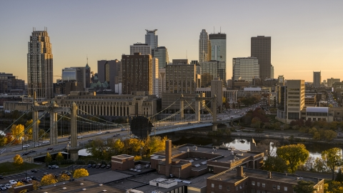 DXP001_000420 - Aerial stock photo of Hennepin Avenue Bridge spanning the river at sunset, with the skyline in the background, Downtown Minneapolis, Minnesota