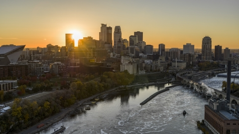 DXP001_000425 - Aerial stock photo of The sun setting behind the city skyline, seen from over the Mississippi River, Downtown Minneapolis, Minnesota