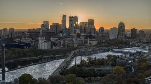 DXP001_000426 - Aerial stock photo of The city skyline, seen from a bridge over the Mississippi River at sunset, Downtown Minneapolis, Minnesota