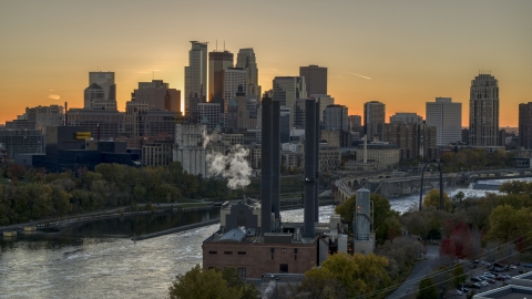 DXP001_000429 - Aerial stock photo of The city skyline on the other side of the river at sunset, seen from power plant, Downtown Minneapolis, Minnesota