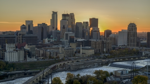 DXP001_000430 - Aerial stock photo of The city skyline on the other side of the bridge and river at sunset, Downtown Minneapolis, Minnesota