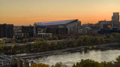 DXP001_000433 - Aerial stock photo of US Bank Stadium on the other side of the river at sunset, Downtown Minneapolis, Minnesota