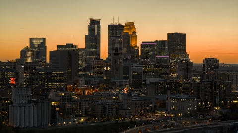 DXP001_000441 - Aerial stock photo of The city's towering skyline at twilight, Downtown Minneapolis, Minnesota