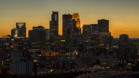 DXP001_000442 - Aerial stock photo of The towering skyline at twilight, Downtown Minneapolis, Minnesota