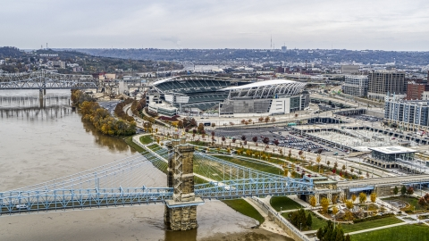 DXP001_000459 - Aerial stock photo of Paul Brown Stadium football field seen from Roebling Bridge and Ohio River in Downtown Cincinnati, Ohio