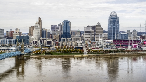 DXP001_000461 - Aerial stock photo of City skyline behind the baseball stadium by the Ohio River in Downtown Cincinnati, Ohio