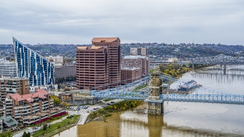 DXP001_000465 - Aerial stock photo of Condo complex and two office buildings by the Roebling Bridge spanning Ohio River in Covington, Kentucky