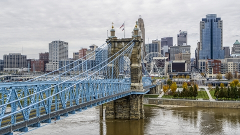 DXP001_000469 - Aerial stock photo of The Roebling Bridge spanning the Ohio River with the city skyline in the background, Downtown Cincinnati, Ohio