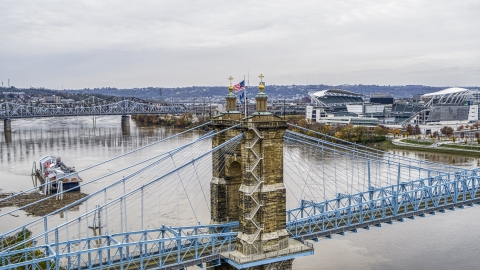 DXP001_000474 - Aerial stock photo of The Roebling Bridge spanning the Ohio River, Downtown Cincinnati, Ohio