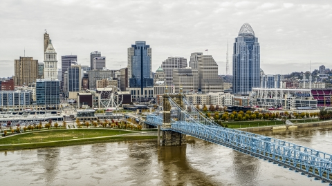 DXP001_000476 - Aerial stock photo of City's skyline and the Roebling Bridge across the Ohio River, Downtown Cincinnati, Ohio